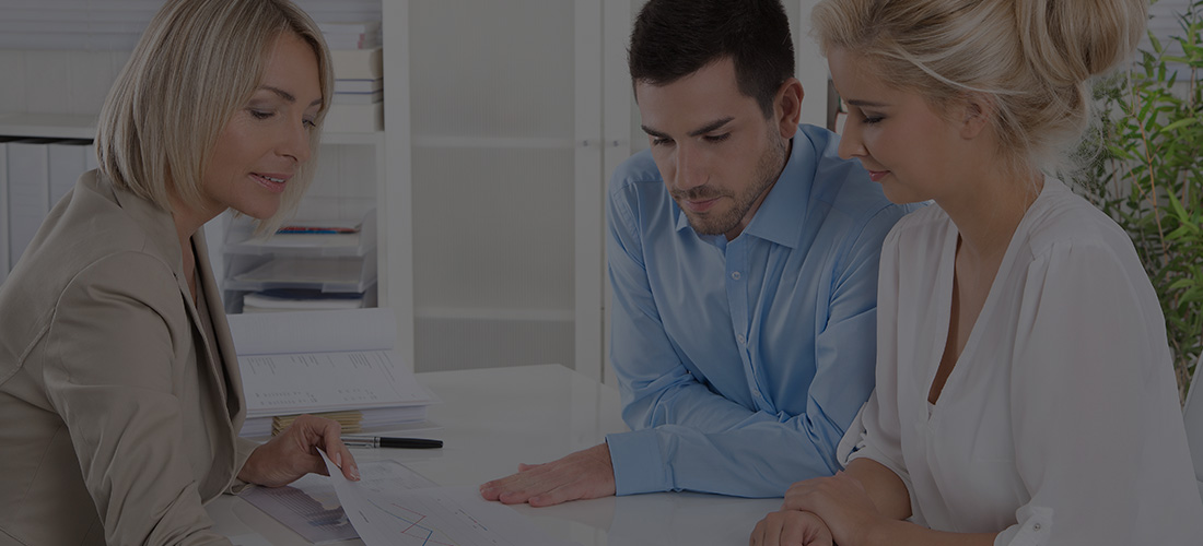 women and man listening to advisor